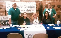 MULTI-AGENCY RESOURCE CENTER (MARC)—​Catholic Charities of Southern Missouri (CCSOMO)​ Regional Director Kyle Schott and CCSOMO Disaster Case Managers Tyree Chapman, Robin Walters, and Crystal Gilliland along with a representative from Catholic Charities of Missouri (standing) ​posed for a photo Jan. 8 as they ​respond to the needs of flood victims at the Multi-Agency Resource Center (MARC) in Cape Girardeau.​ Want to help? Consult www.ccsomo.org. (The Mirror)