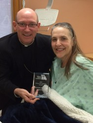 CITIZEN RECOGNITION AWARD—Despite being hospitalized, Margaret Ann Mhoon received her Citizen Recognition Award from the Missouri Catholic Conference. Bishop Edward Rice presented the award to Mhoon in Southeast Hospital on Dec. 1.  The annual award from the MCC recognizes individuals who promote the dignity of human life through Catholic principles. Mhoon is a member of St. Francis Xavier Parish, Sikeston. (The Mirror)