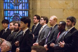 MINISTRY OF ACOLYTE—Saint Meinrad seminarians from right, Gabe Mills, Samuel Mungai, Nicholas Newton, Connor Plessala, and Peyton Plessala, along with their classmates, received the ministry of Acolyte in St. Thomas Aquinas Chapel on Feb. 15, 2018 from Archbishop Charles Thompson, of the Archdiocese of Indianapolis. (The Mirror)