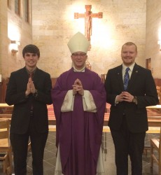 MINISTRY OF LECTOR—Two diocesan seminarians, Nicholas Koeppel and Nicholas Newton, received the ministry of lector on March 2 in St. Meinrad Seminary, St. Meinrad, IN. They are pictured with Bishop Edward M. Rice. (The Mirror)