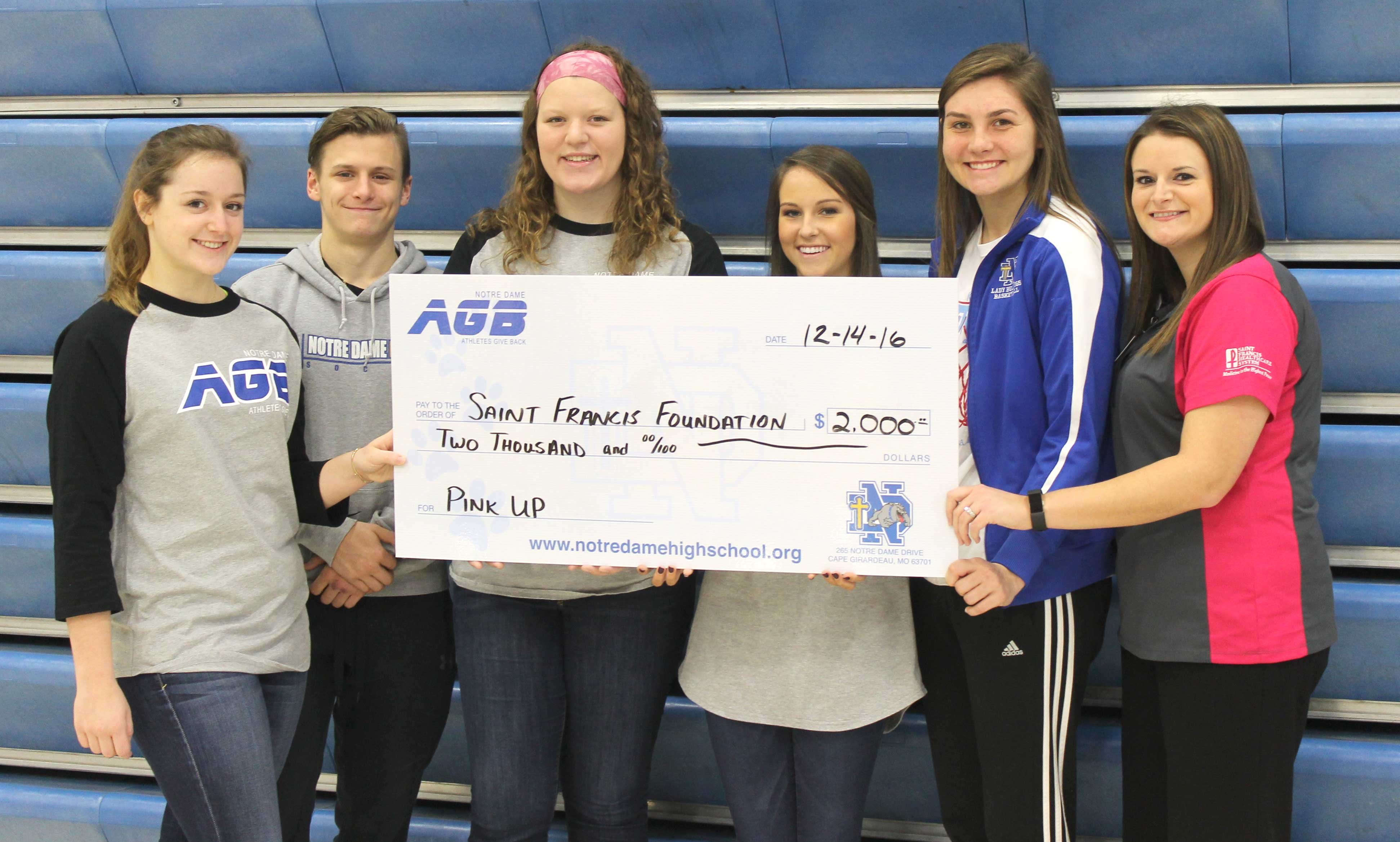 "ATHLETES GIVE BACK—Notre Dame Regional High School, Athletes Give Back (AGB) organization presented a check for $2,000 to the Saint Francis Medical Center Foundation, ""Pink Up"" campaign. Student athletes, Taylor Allen, Ben Womack, Anna Kate Klueppel, Lindsay Parker, and Allie Ziegler, presented the check to Laura Boos Probst, Notre Dame Class of '09, of the Saint Francis Foundation. (??)"