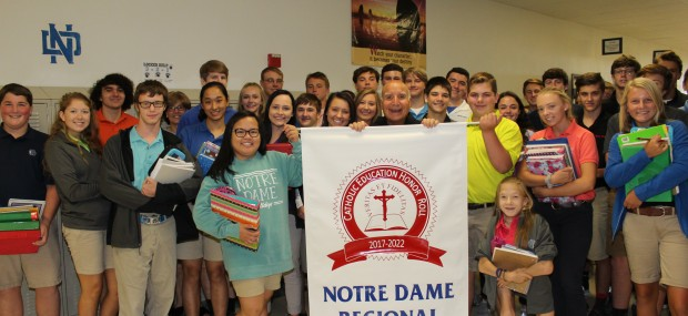 TWELVE YEARS AND COUNTING—Brother David Migliorino, OSF, posed with a group of Notre Dame Regional High School students as they celebrated the school's distinction as a Catholic Education Honor Roll School. The Cape Girardeau high school is home to 507 students where Bro. Migliorino serves as principal. Notre Dame High School been on the list of Catholic Honor Roll schools since 2005.(The Mirror)