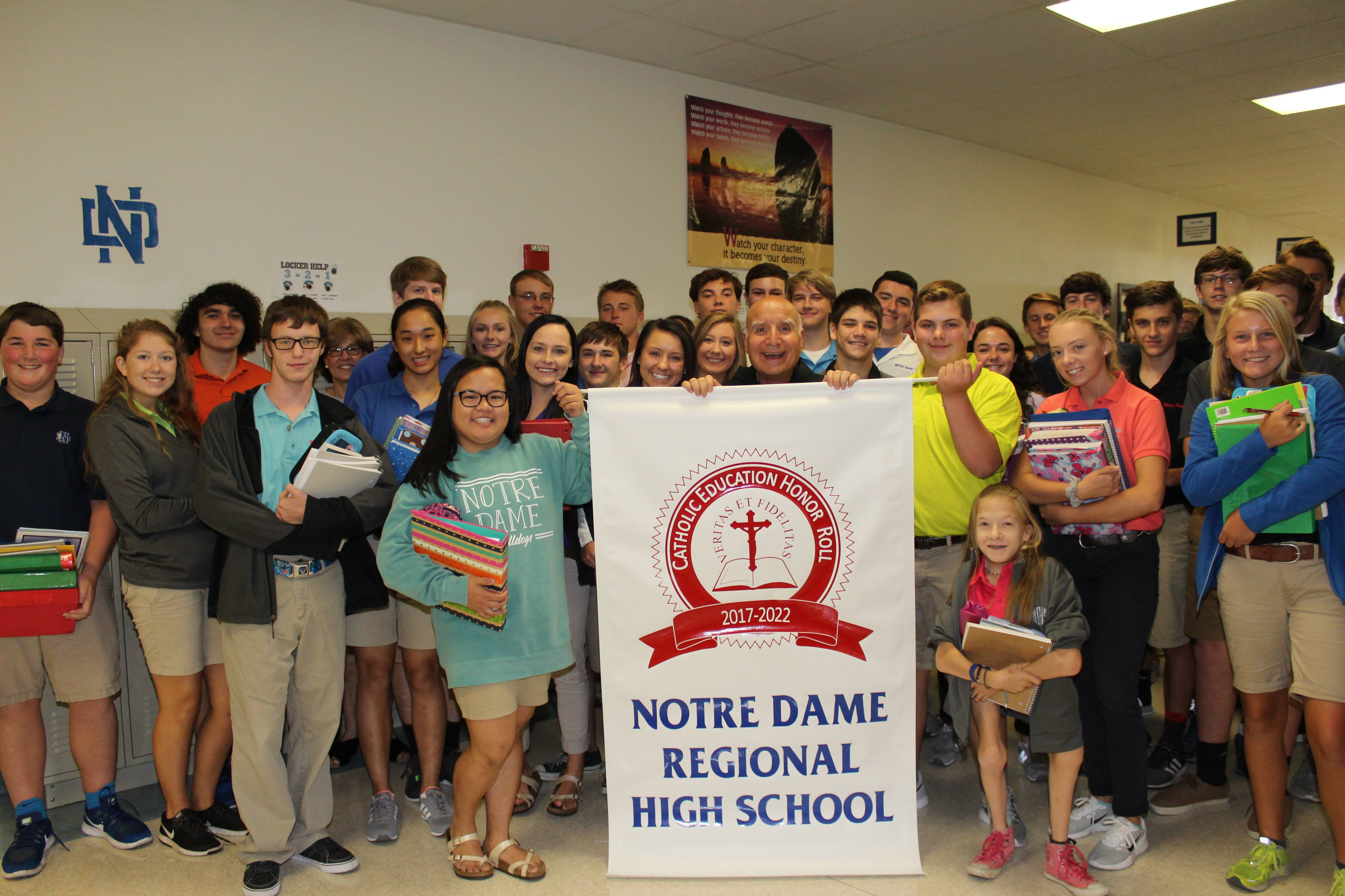 TWELVE YEARS AND COUNTING—Brother David Migliorino, OSF, posed with a group of Notre Dame Regional High School students as they celebrated the school's distinction as a Catholic Education Honor Roll School. The Cape Girardeau high school is home to 507 students where Bro. Migliorino serves as principal. Notre Dame High School been on the list of Catholic Honor Roll schools since 2005. (The Mirror)