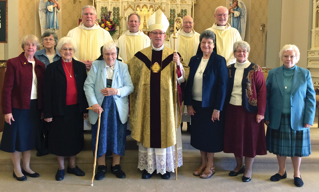100TH ANNIVERSARY—Bishop Edward M. Rice celebrated the parish centennial of Guardian Angel, Oran, on Sun., Nov. 6. Pictured are (front) Sr. Joan Stoverink, Sr. Sharon Van Horn, Sr. Francis Newton, Sr. Jane Kiefer, Bp. Rice, Sr. Mary Jane Jansen, Sr. Helen Moore, and Sr. Jacinta Willenburg; (back) Fr. Norman Varone, retired; Fr. Randy Tocktrop, pastor; Msgr. Richard Rolwing, retired; and Fr. John Harth. Bishop Rice's homily may be found Online at www.dioscg.org. (The Mirror)
