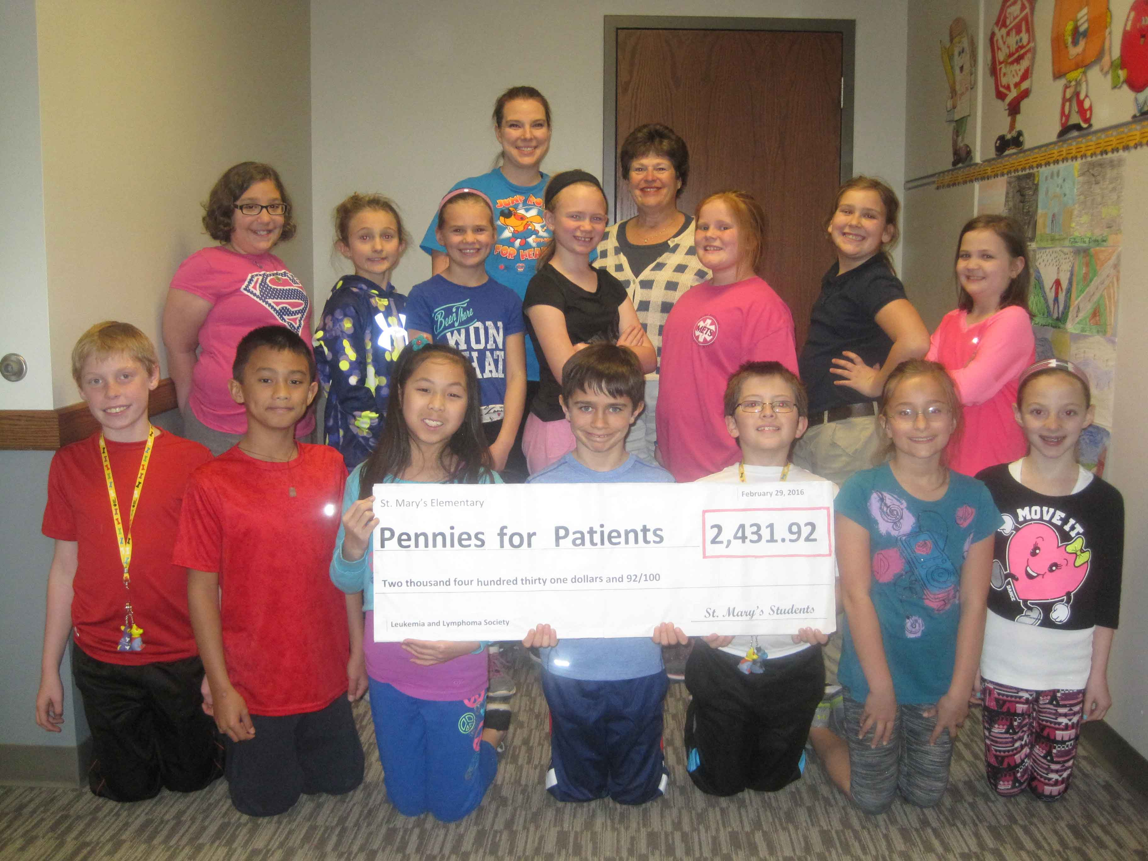 PENNY WAR—​St. Mary​ Catholic​ School in Joplin had a penny war ​recently ​to raise money for the Leukemia and Lymphoma Society (LLS). The​ ​organization helps fund research for blood cancers, as well as provide education and patient services. The students brought in change over the course of​ seven ​days, and raised a total of $2​,​431.92! They had so much fun competing with other classes and raising money for a great cause. Pictured ​were​ Mrs. Carly Barwick​, ​her students​, and ​St. Mary School Principal Ann Hamlet. (The Mirror)​