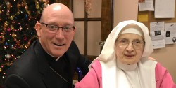 "71 YEARS A 'PINK SISTER'—Bishop Rice posed for a photo with Sr. Mary Bertha Horning, SVD, of the Sisters of Mt. Grace in St. Louis. Often called ""Pink Sisters"" because of the color of their habit, Sr. Horning is from St. Joseph Parish, Springfield, and has been a Holy Spirit Adoration Sister for 71 years. (The Mirror)"