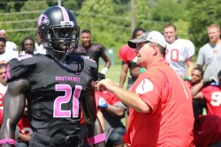 """PINK UP FOR BREAST CANCER—Southeast Football head coach Tom """"Tuke"""" Matukewicz revealed the 2016 Pink Up game jerseys to the Redhawks football team on Aug. 11. The jerseys will be auctioned off and personalized with the winners' names then worn during a special Pink Up game on Oct. 29. Proceeds from the auction benefit Saint Francis Healthcare System's Dig for Life fund to provide lifesaving screenings and other cancer services to local residents who otherwise could not afford them. The auction is Online through Oct. 8 at www.pinkupcape.com.(Photo by Saint Francis Medical Center)"""