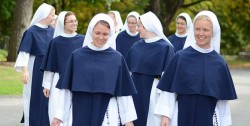 """'YOU ARE NOT ALONE'—Walk along in Washington's March for Life and you may see them: a swarm of young women dressed in long blue habits, white veils blowing in the breeze. They are the Sisters of Life and they have a message for women and for the pro-life movement: """"You are not alone."""" (Photo courtesy Sisters for Life)"""