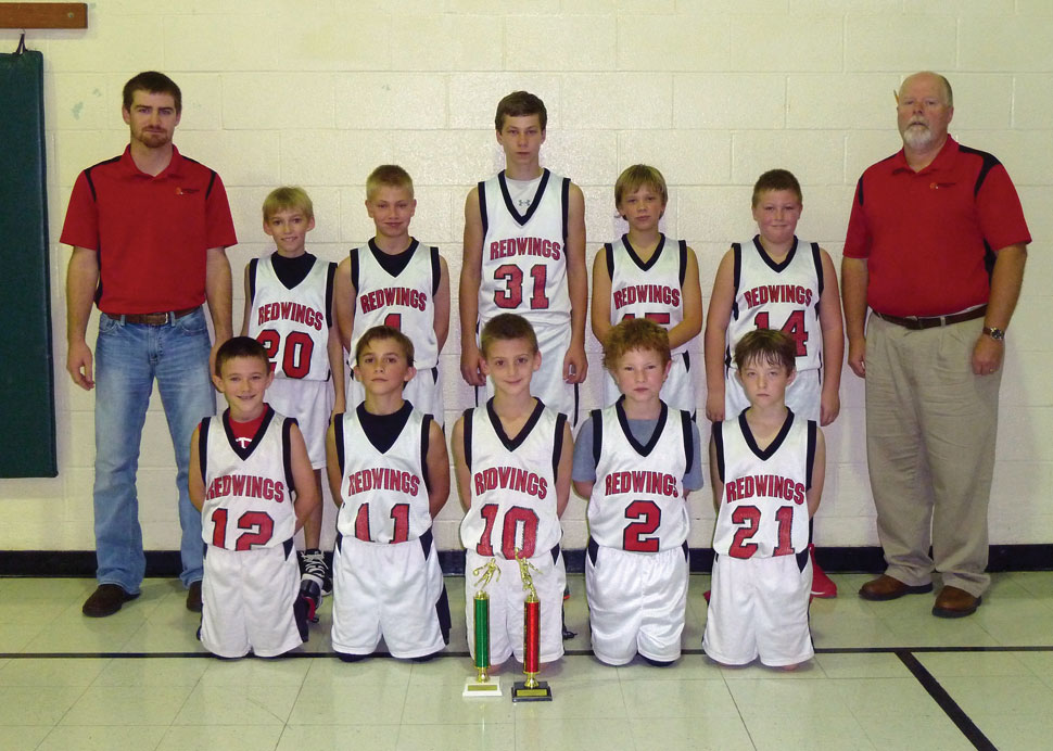 BLUE RIBBON REDWINGS—The Guardian Angel Redwings of Oran, MO, participated in the the junior varsity basketball tournament at St. Joseph School, Scott City, on December 9, 11, and 12, where they received First Place and were undefeated in the Christian Youth League.   Pictured ​were​:  ​(front row) ​Owen Forehand, Riley Schlosser, Nolan Loper, Drew Pobst, ​and​ Lawson Hahn​; (back row) ​Coach Andrew Hulshof, Kyle Eftink, Gabe Dirnberger, Logan Rose, Connor Watkins, Nathaniel Woods, ​and​ Coach Kent Mangels. (Submitted photo)
