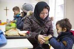 GLOBAL SOLIDARITY—A Caritas Athens soup kitchen for refugees in Greece. (Photo by Elie Gardner/Catholic Relief Services)