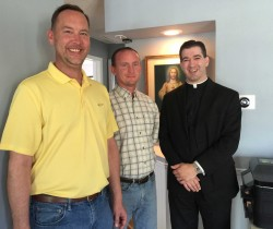 PARISH OFFICE OPEN HOUSE—Sacred Heart Parish, Salem, celebrated an open house April 22, 2016, for its new parish office. Pictured were Wayne Martin and Brian Cahill from Cahill Construction, Salem, that oversaw the renovation, along with Fr. William Hennecke, Jr., Pastor. (Submitted photo)