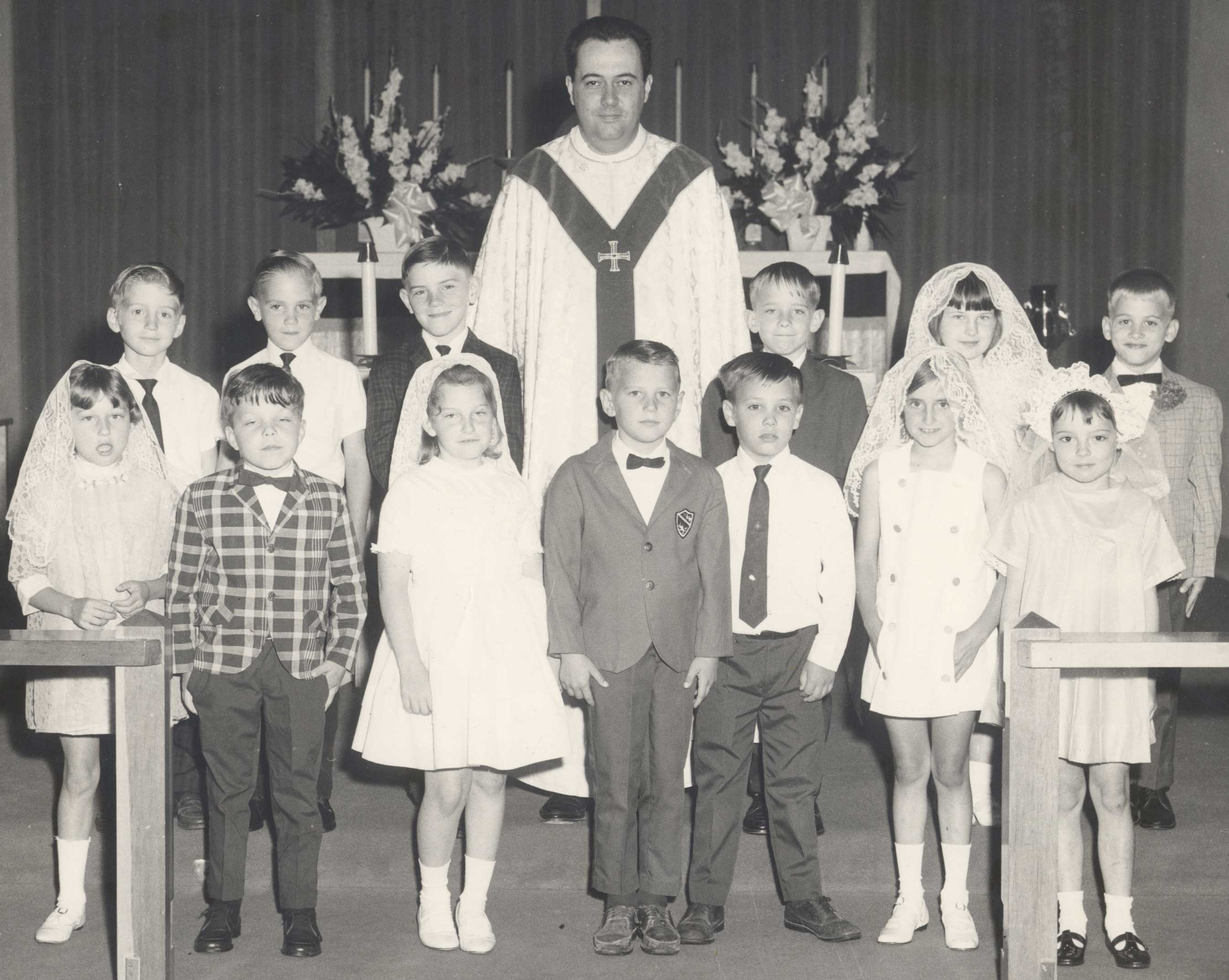 "FIRST COMMUNION—(circa 1968) Msgr. William ""Bill"" Stanton is pictured with a group of First Communicants in Sacred Heart Parish, Caruthersville, MO, where he served at pastor from 1967-1971. A Founding Priest of the Diocese of Springfield-Cape Girardeau, Msgr. Stanton died Jan. 18, 2017. He was among one of the first priests serving in the ""new"" diocese in southern Missouri, carved out of the Diocese of Kansas City and the Archdiocese of St. Louis in 1956. Then-Father Stanton requested to be incardinated into the Diocese of Springfield-Cape Girardeau from the Archdiocese of St. Louis, and was granted his wish by Cardinal Joseph Ritter in 1958. (The Mirror)"