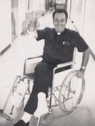 "FLOAT INJURY—(circa 1973) An avid outdoorsman, Msgr. William ""Bill"" Stanton was injured in a floating accident in 1973. The photo cutline in The Mirror read: Fr. Bill Stanton, pastor of St. Mary Parish in Joplin, is a frequent visitor to St. John's Medical Center, but usually comes to visit the patients, rather than being one himself.  An active member of the Society for the Preservation and Encouragement of Barbershop Quartet Singing in America, Inc., Fr. Stanton was on the organizations float trip in the Joplin Centennial Parade July 4 (1973) when a sudden stop-and-start sent him to the pavement. He is shown here managing a smile, even after his physician told him he should be able to discard the crutches in about six weeks. (The Mirror)"