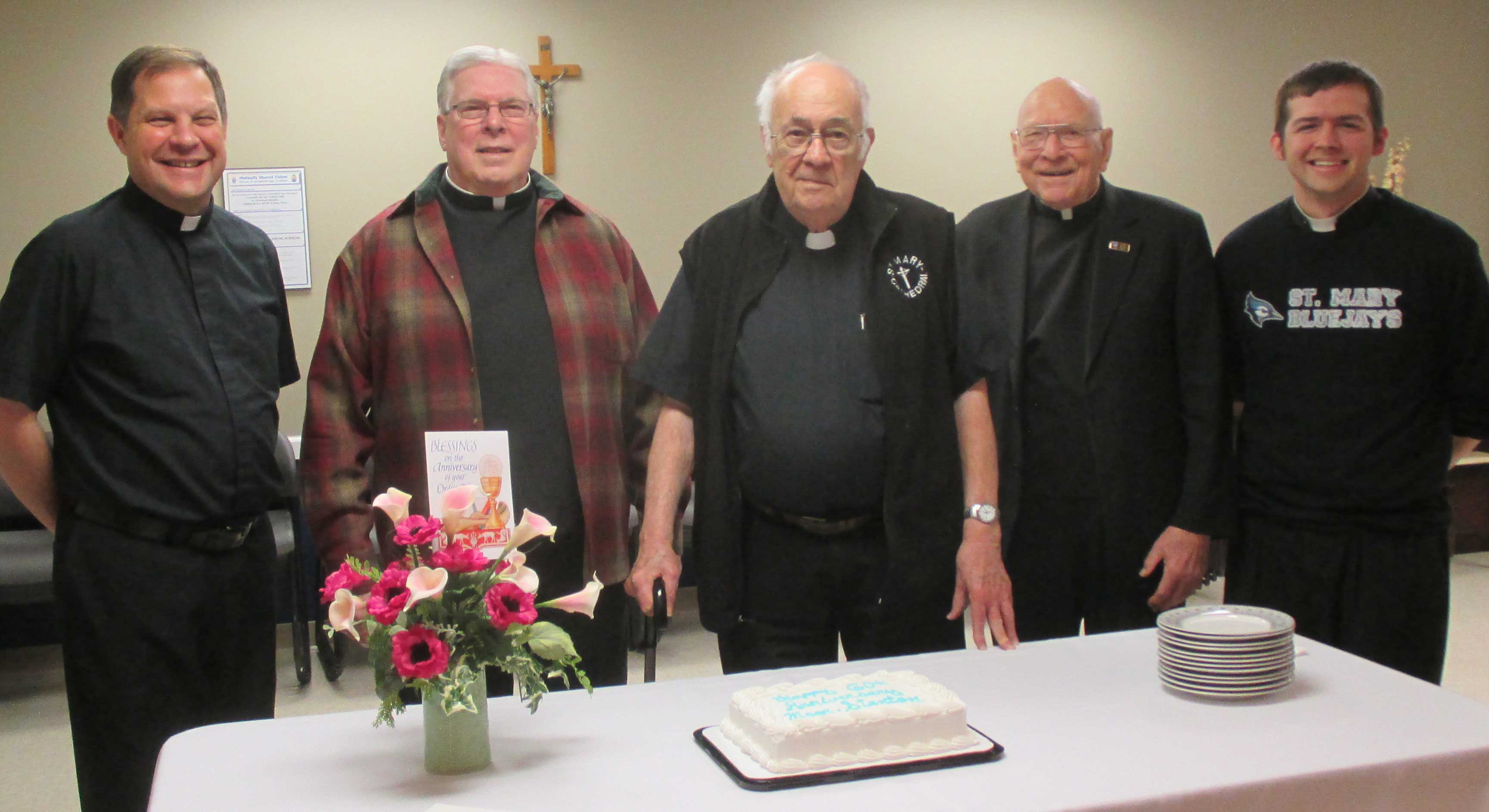 60th ANNIVERSARY—The staff at St. Mary of the Annunciation Cathedral held a luncheon in honor of Msgr. William Stanton's 60th Anniversary as a priest March 18, 2016, in the parish hall. Pictured were Fr. Allan Saunders, pastor; Fr. Normand Varone, retired; Msgr. William Stanton, retired; Msgr. Richard Rolwing, retired; and Fr. Joseph Kelly, associate pastor. Msgr. Stanton is a classmate of Bp.-Emeritus John J. Leibrecht who also graduated from Kenrick-Glennon Seminary in St. Louis on March 17, 1956. (Photo by Lisa Simmons)