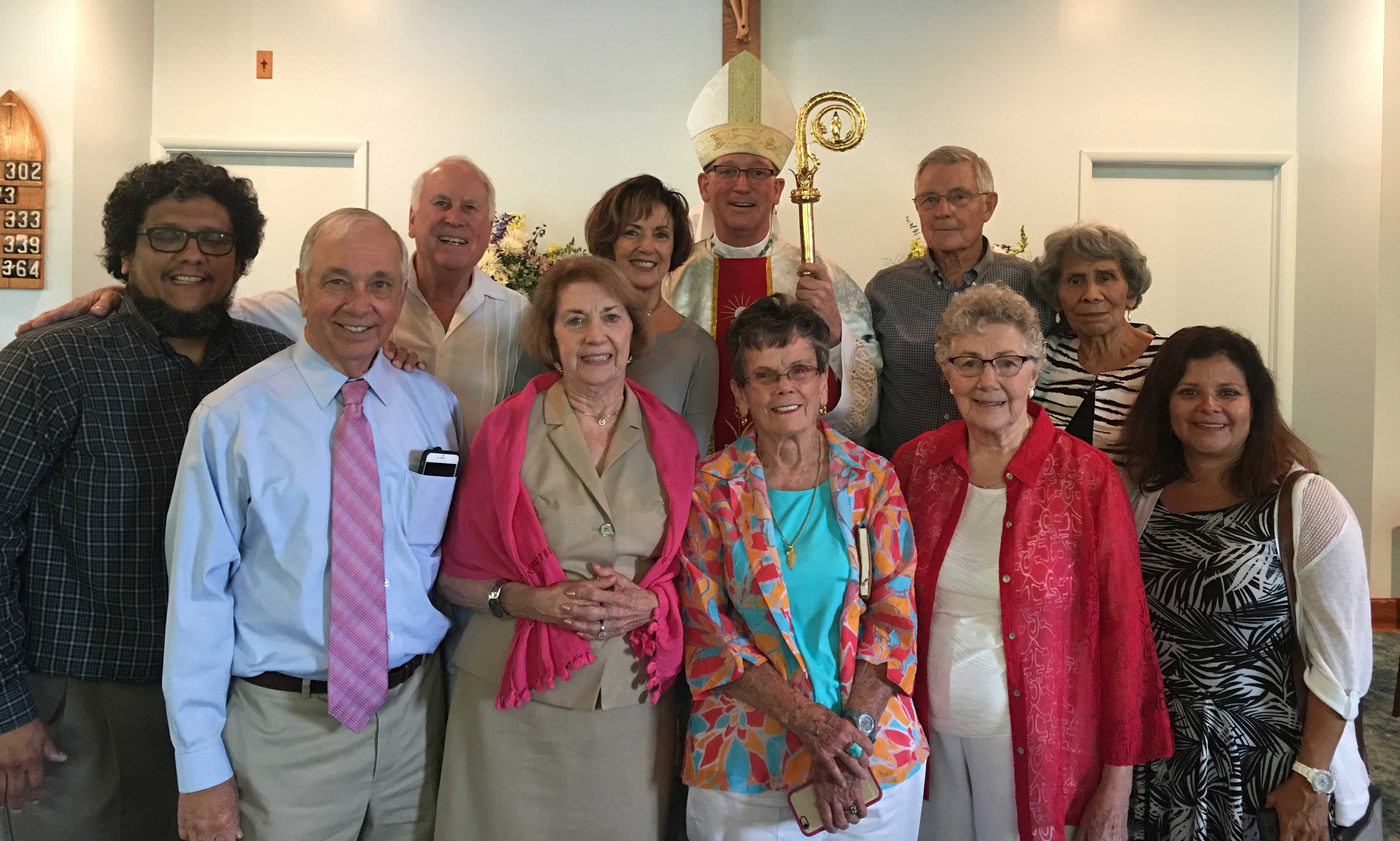 THE OWEN & HELEN BEST FAMILY—Owen and Helen Best, deceased, donated the land for the current Sacred Heart Church. Pictured is the young generation of the Best family onhand at the June 18 liturgy: (front) David Best, Leo Saenger, Pat Best Saenger, Treasa Weaver, Mary Best, Christina Best; (back row) Wayne Unze, Margeret Best Unze, Bp. Edward Rice, Leon Best, and Dora Best. (The Mirror)