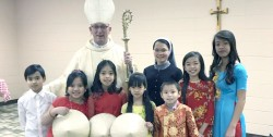 YEAR OF THE DOG—Bishop Edward M. Rice marked the launch of the Year of the Dog Feb. 11, 2018, the Vietnamese Lunar New Year, including Mass and festivities in St. Agnes Cathedral, Springfield. (The Mirror)