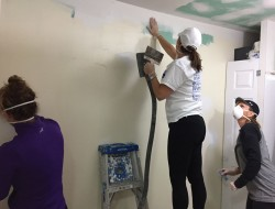 NEW SKILL SETS—Melissa McGuire, Dana Parker and Maria Gates prepped the walls of a home in Cape Girardeau damaged in the New Year's flood. The Friday morning women's bible study repairs homes when they aren't studying Scripture at St. Vincent de Paul Parish. (The Mirror)