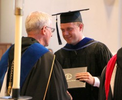 BACHELOR'S DEGREE—Seminarian Joshua Carroll received his Bachelor of Art's degree from Abbot Benedict Neenan, OSB, May 13, during commencement ceremonies at Conception Seminary College. (Submitted photo)
