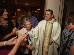 CONGRATULATIONS—(Above) Newly-ordained Fr. Francisco Gordillo greeted people after his ordination to the priesthood Aug. 5 in St. Elizabeth Ann Seton Parish, Springfield. Fr. Gordillo will be associate pastor in St. Vincent de Paul Parish, Cape Girardeau, where he has served as a deacon since June. (Photos by Dean Curtis/The Mirror)